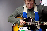 Guitar teacher reviewing cords in a practice room. St Paul Minnesota USA