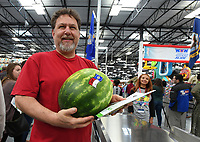 NWA Democrat-Gazette/J.T. WAMPLER Carlos Vasquez of Springdale carries his watermelon after making the first purchase Thursday May 25, 2017 at the grand opening of  the Springdale Sam's Club. The club is located in west Springdale on 56th St. and is the first Sam's Club in the city for nearly a decade. Vasquez says he was the first customer at the Pleasant Crossing Wal-Mart in Rogers and at the Elm Springs Wal-Mart in Springdale.
