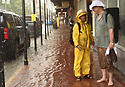 Musicians John Boutte and Mark McGrain get stranded after heavy rains flooded streets in the historic French Quarter after city pumps were overwhelmed, sending residents and tourists scurrying for dry land, New Orleans, Sat., Aug. 5, 2017. (Photo by Cheryl Gerber)