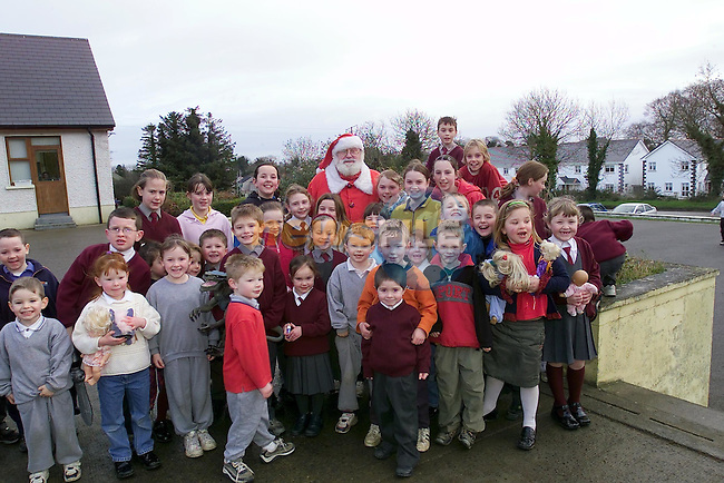 Children from Tullyallen National school with santa after he paid a visit to the school..Picture Fran Caffrey Newsfile.