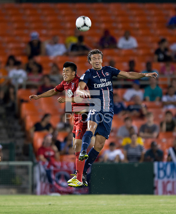 Diego Lugano (15) of Paris Saint-Germain FC goes up for a header with Long Tan (27) of D.C. United during the game at RFK Stadium in Washington, DC.  Paris Saint-Germain FC tied D.C. United, 1-1.