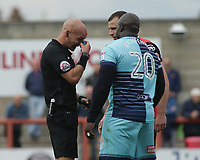 Match Official Darren Drysdale, players a joke on, Adebayo Akinfenwa of Wycombe Wanderers, who has just fouled Dean Winnard of Morecambe, he goes to his pocket but instead of issuing a yellow card, decides to pull out his handkerchief to wipe his nose during the Sky Bet League 2 match between Morecambe and Wycombe Wanderers at the Globe Arena, Morecambe, England on 29 April 2017. Photo by Stephen Gaunt / PRiME Media Images.