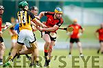 David Egan and Niall O'Mahony Abbeydorney in action against Mark Dineen Ballyheigue in the Kerry County Hurling Championship at Austin Stack Park Tralee on Sunday.