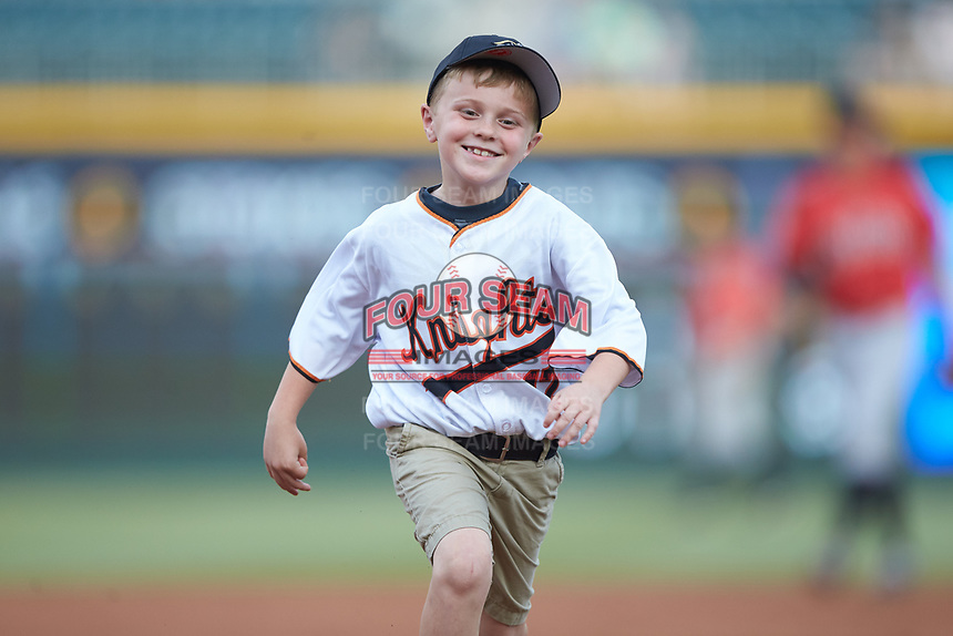 A young fan runs the bases between innings of the International League game between the Indianapolis Indians and the Charlotte Knights at BB&T BallPark on May 26, 2018 in Charlotte, North Carolina. The Indians defeated the Knights 6-2.  (Brian Westerholt/Four Seam Images)