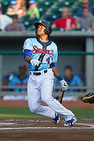 Addison Russell (4) of the Tennessee Smokies follows through on his swing against the Mississippi Braves at Smokies Park on July 22, 2014 in Kodak, Tennessee.  The Smokies defeated the Braves 8-7 in 10 innings. (Brian Westerholt/Four Seam Images)