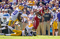 NWA Democrat-Gazette/BEN GOFF @NWABENGOFF<br /> Devwah Whaley, Arkansas running back, tries to break the tackle of Kevin Toliver, LSU cornerback, in the second quarter Saturday, Nov. 11, 2017 at Tiger Stadium in Baton Rouge, La.