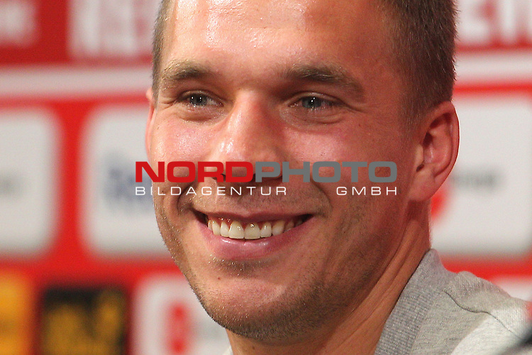 02.05.2012, Rhein Energie Stadion, Koeln, GER, 1.FBL, 1. FC Koeln Pressekonferenz Abschied Lukas Poldoski, im Bild<br /> Lukas Podolski (Koeln #10) lacht<br /> <br /> // during the 1.FBL Press-Conference, 1. FC KoelnLukas Podolski on 2012/05/02, Rhein-Energie Stadion, K&ouml;ln, Germany. Foto &copy; nph / Mueller *** Local Caption ***