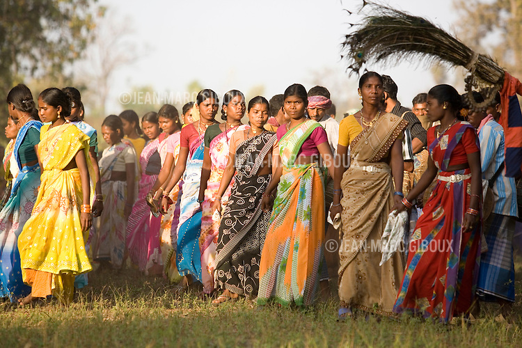 """PHARASPAL, DANTEWARA DISTRICT, CHHATTISGARH, INDIA, FEBRUARY 26, 2008 :  Malai festival in Pharaspal, a village of Dantewara district in the state of Chhattisgarh. The southern region of Chhattisgarh is part of India's tribal belt and three fourth of the population are tribal, mainly from the Gond tribe and sub-tribes. They live in villages throughout the region, in the mountain, the jungle, and have preserved their traditional way of life and traditions by being isolated from India's march forward. In this area, the Maoist insurgency called Naxalites have been waging a war against the government for the past 25 years and has been gaining momentum in in the past few years. They are present in some 150 of the 600 districts of India, and Dantewara is one of Chhattisgarh rural Maoist stronghold where they control most of the countryside. The overwhelmed police force is hiring more personel to deal with the Naxalite threat and the Government has armed civil defence anti-naxalite milicias to take on the naxalites , emptying villages to cut local support to the rebels. The movement called """"Salwa Judum"""" (campaign for peace)  started in june 2005 when some villages took a stand against the Maoists, but it is now dragging the whole district into the bloody civil war, at the expense of the  local tribal villagers caught in the middle and forced to leave their ancestral homes for the security of refugee camps. The conflict has claimed over 900 lives in 2006 and again in 2007, and some 50 to 60,000 people live in makeshift camps, protected by the Salwa Judum and the police force. But for the tribals who do not want to leave their home and villages, there are no government services available, meaning no health care or education for the children. They live in complete isolation from the rest of India. (Photo by Jean-Marc Giboux/ GettyImages)"""