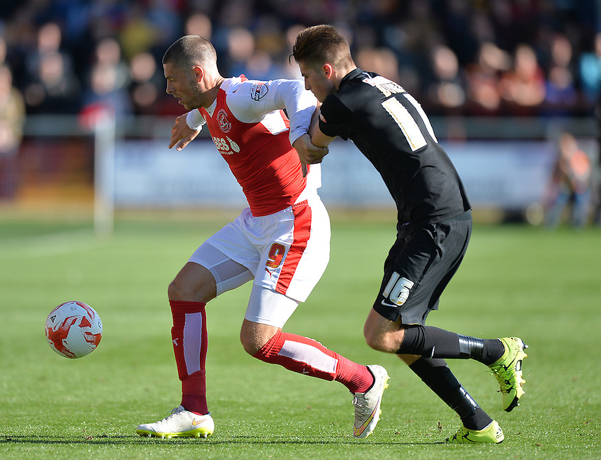 Fleetwood Town's Jamie Proctor battles with  Bradford City's Reece Burke<br /> <br /> Photographer Dave Howarth/CameraSport<br /> <br /> Football - The Football League Sky Bet League One -  Fleetwood Town v Bradford City - Saturday 12th September 2015 -  Highbury Stadium - Fleetwood <br /> <br /> &copy; CameraSport - 43 Linden Ave. Countesthorpe. Leicester. England. LE8 5PG - Tel: +44 (0) 116 277 4147 - admin@camerasport.com - www.camerasport.com