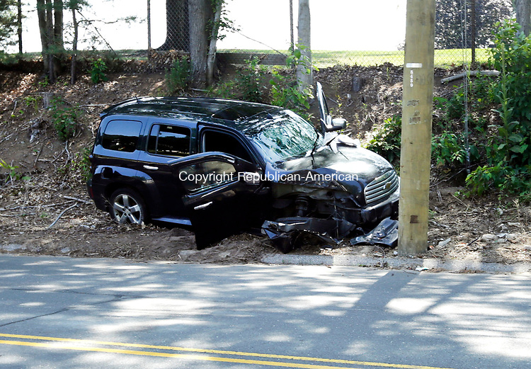 Waterbury, CT- 04 August 2017-080417CM04-  A vehicle struck a utility pole along Oronoke Road in Waterbury on Friday.  The collision occurred near the intersection of  Chipman Street. Christopher Massa Republican-American