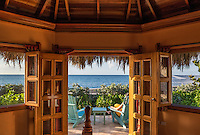 Spa hotel cottage with thatched roof, Jamaica.