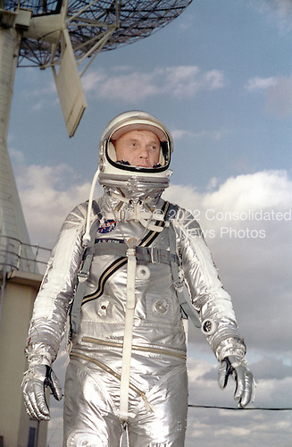 Astronaut John H. Glenn Jr. in his silver Mercury spacesuit during pre- flight training activities at Cape Canaveral. On February 20, 1962 Glenn lifted off into space aboard his Mercury Atlas (MA-6) rocket and became the first American to orbit the Earth. After orbiting the Earth 3 times, Friendship 7 landed in the Atlantic Ocean 4 hours, 55 minutes and 23 seconds later, just East of Grand Turk Island in the Bahamas. Glenn and his capsule were recovered by the Navy Destroyer Noa, 21 minutes after splashdown..Credit: NASA via CNP
