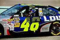 Coverage of Jimmie Johnson, driver of the #48 Lowe's Chevrolet, climbs into his car during practice for the NASCAR Sprint Cup Series Ford 400 in Homestead-Miami Speedway in Homestead, Florida.
