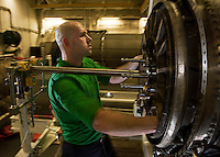 110425-N-DR144-094 ARABIAN SEA (April 25, 2011) Aviation Machinist's Mate Airman Dwayne Dill, assigned to Aircraft Intermediate Maintenance Department's (AIMD) IM-2 Division, reassembles an F414 turbofan in IM-2's power plant shop aboard Nimitz-class aircraft carrier USS Carl Vinson (CVN 70).  Carl Vinson and Carrier Air Wing (CVW) 17 are conducting maritime security operations and close-air support missions in the U.S. 5th Fleet area of responsibility. (U.S. Navy photo by Mass Communication Specialist 2nd Class James R. Evans / Released)