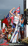 KAILUA-KONA, HI - OCTOBER 13:  Leanda Cave of Great Britain crosses the finish line to win the 2012 IRONMAN World Championships on October 13, 2012 in Kailua-Kona, Hawaii. (Photo by Donald Miralle)