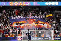 New York Red Bulls fans celebrate a goal. The New York Red Bulls defeated the New England Revolution 2-0 during a Major League Soccer (MLS) match at Red Bull Arena in Harrison, NJ, on October 21, 2010.