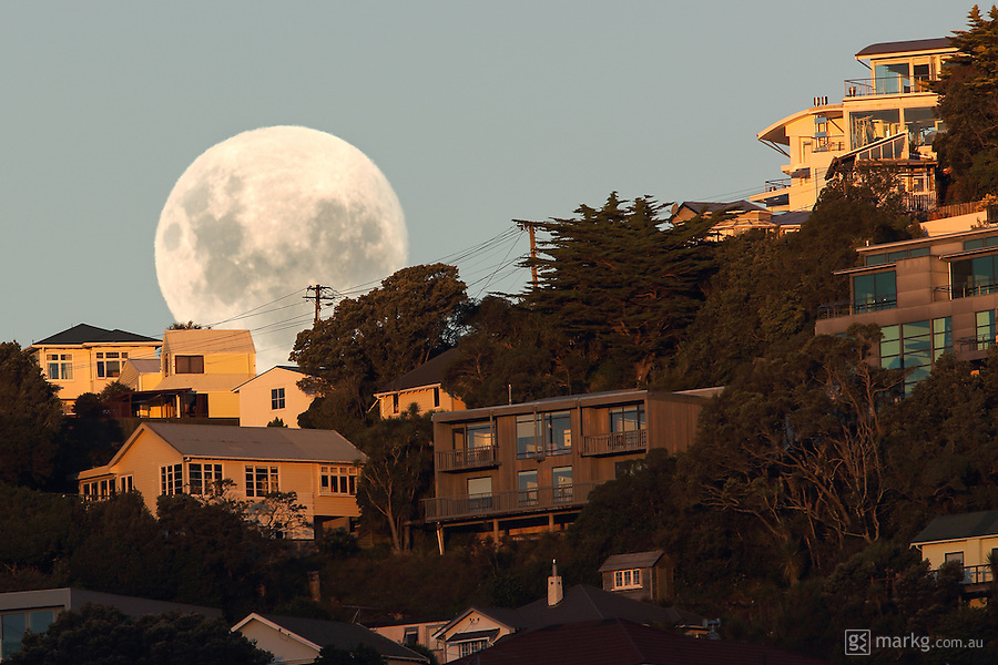The supermoon rises over Mount Victoria in Wellington New Zealand just on sunset on the 5th May 2012. It's the biggest and brightest moon of 2012, coming within a distance of 356,955kms from earth.