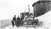 Rear of D&amp;RG flanger, left-hand blade extended.  Its crew is posing for the camera next to the Cumbres covered turntable.<br /> D&amp;RG  Cumbres, CO  Taken by Lively, Charles R. - circa 1910
