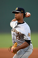 Starting pitcher Rony Garcia (19) of the Charleston RiverDogs delivers a pitch in Game 2 of the South Atlantic League Southern Division Playoff against the Greenville Drive on Friday, September 8, 2017, at Fluor Field at the West End in Greenville, South Carolina. Charleston won, 2-1, and the series is tied at one game each. (Tom Priddy/Four Seam Images)