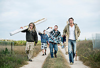 From left, Zachary Sobol (cq), Michael Atchley (cq), and Jared Stanley (cq) walk to the farm to prepare for harvest of industrial grade hemp near Wray, Colorado, Monday, September 22, 2014. The Stanley Brothers have developed a popular strain of marijuana that has been found to be helpful in reducing seizures. The marijuana high in CBDs and low in THC, the chemical which gets a person stoned.<br /> <br /> Photo by Matt Nager
