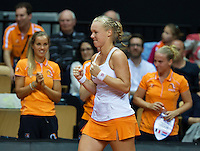 Arena Loire,  Trélazé,  France, 16 April, 2016, Semifinal FedCup, France-Netherlands, First match: Kiki Bertens vs Caroline Garcia, Kiki Bertens (NED) icelebrates her win with  her team members Arantxa Rus (L) and Richel Hogenkamp<br /> Photo: Henk Koster/Tennisimages