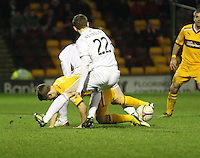 Henrik Ojamaa sandwiched between Scott Vernon and Mark Reynolds (22) in the Motherwell v Aberdeen, Clydesdale Bank Scottish Premier League match at Fir Park, Motherwell on 26.12.12..