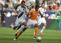 CARSON, CA - DECEMBER 01, 2012:   Juninho (19) of the Los Angeles Galaxy battles for the ball with Calen Carr (3) of the Houston Dynamo during the 2012 MLS Cup at the Home Depot Center, in Carson, California on December 01, 2012. The Galaxy won 3-1.