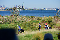Justin Thomas (USA) makes his way down 10 with the statue of Liberty in the distance during round 1 foursomes of the 2017 President's Cup, Liberty National Golf Club, Jersey City, New Jersey, USA. 9/28/2017.<br /> Picture: Golffile | Ken Murray<br /> ll photo usage must carry mandatory copyright credit (&copy; Golffile | Ken Murray)