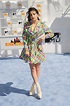 LOS ANGELES, CA - APRIL 12:  Singer Charli XCX arrives at the 2015 MTV Movie Awards at Nokia Theatre L.A. Live on April 12, 2015 in Los Angeles, California.