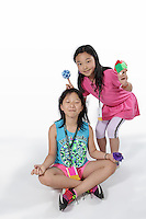 OrigamiUSA 2016 Convention at St. John's University, Queens, New York, USA. Ellen Chen, 10, Rye, New York (right). Allison Wang, Winchester, Massachusetts (left). First timers at the OUSA 2016 Convention.