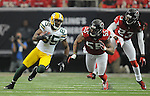 Green Bay Packers receiver Greg Jennings, left, runs on a first down catch near Atlanta Falcons John Abraham (55) and Dunta Robinson during the first quarter of the game at the Georgia Dome in Atlanta, Ga., on Nov. 28, 2010.