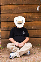 Usa,Wyoming, Cheyenne,a sleeping cowboy at Frontier days 2017