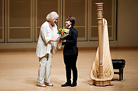 USA International Harp Competition Vice President Linda Wood Rollo gives flowers to performer Xinyue Zhang during the Stars of Tomorrow Concert at the 11th USA International Harp Competition at Indiana University in Bloomington, Indiana on Thursday, July 11, 2019. (Photo by James Brosher)