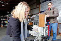 NWA Media/DAVID GOTTSCHALK - 12/31/14 - Amber Sharp,  left, household hazardous waste operator, collects cables and power cords dropped off by Craig Edmonston (cq), right,  Wednesday December 31, 2014 at the Washington County Environmental Affairs and Recycling Household Hazordous Waste Drop-Off in Fayetteville. The facility along with Boston Mountain Solid Waste in Prairie Grove,  has eliminated fees for up to 10 items through January 16, 2015.