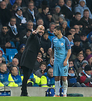 Manchester City Manager (Head Coach) Josep Guardiola talks to Nolito of Manchester City during the UEFA Champions League GROUP match between Manchester City and Celtic at the Etihad Stadium, Manchester, England on 6 December 2016. Photo by Andy Rowland.