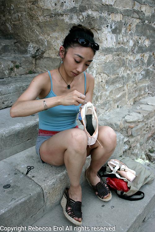 Hikaru Kobayashi, Royal Ballet dancer, darns shoes before the performance