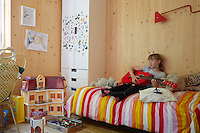 The artist Richard Woods has built a timber house where he can both create and showcase his bold, bright work.  Woods shares with his wife Jess Spanyol, a children's book author, and their three children. 10-year-old Augusta in her bedroom.