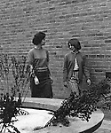 Bethel Park Senior High School:  View of students walking through building 1's courtyard to get to their next class - 1964.  Marianne Kozora is on the right. The new Bethel Senior High School was dedicated on October 23, 1960, but the campus would not grow to its current size until seven years later. Phase II of the construction was completed in 1964 with the addition of another academic building and the industrial arts building. Phase III was completed in 1967 with the construction of the fourth academic building and a 6,300 seat football stadium and track, three tennis courts, seven basketball courts and a baseball field.