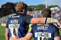 Olly Barkley with captain Stuart Hooper after the former has just played his final match for Bath Rugby this season. Aviva Premiership match, between Bath Rugby and Sale Sharks on September 29, 2012 at the Recreation Ground in Bath, England. Photo by: Patrick Khachfe / Onside Images