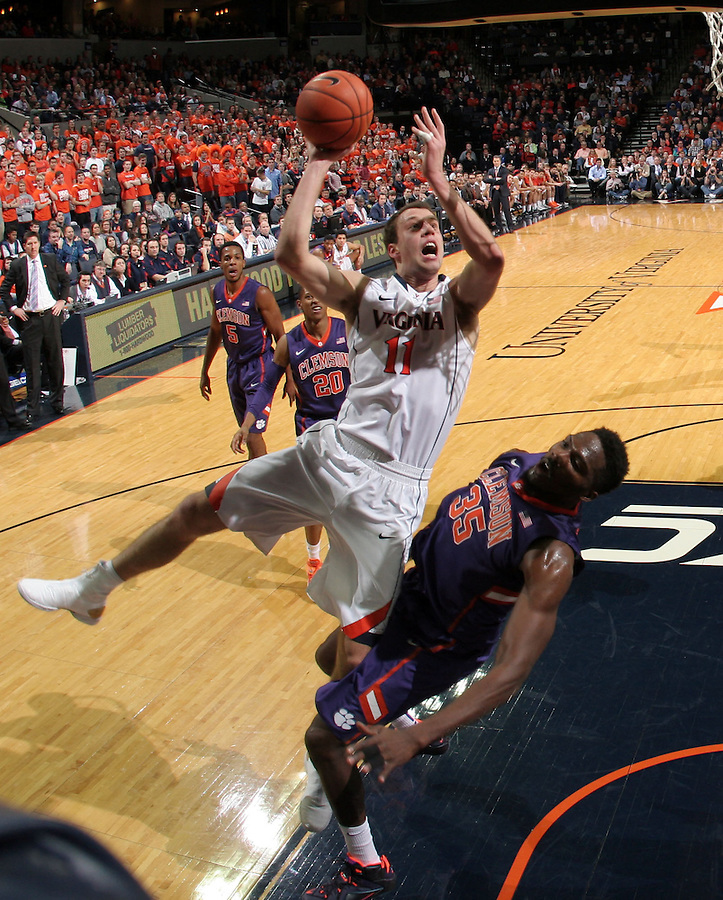 Virginia forward Evan Nolte (11) shoots over Clemson center Landry Nnoko (35) during an ACC basketball game Jan. 13, 2015 in Charlottesville, VA Virginia won 65-42.
