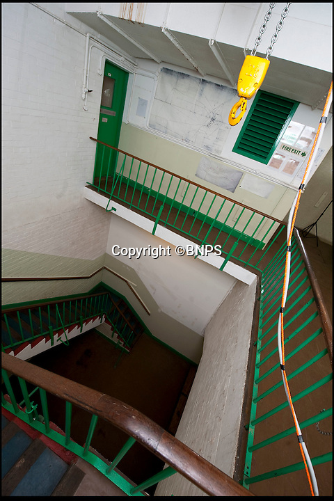BNPS.co.uk (01202 558833)<br /> Pic: PhilYeomans/BNPS<br /> <br /> Vast entrance hall.<br /> <br /> Fed up with your neighbours...This Cold War bunker boasting 56 rooms, metre thick walls and no windows could be the perfect country retreat.<br /> <br /> The former top secret nuclear bunker on a remote Devon clifftop was built to shelter local officials in the chilling event of a Soviet strike on nearby Plymouth.<br /> <br /> The 30,000 sq ft shelter, built at the height of the Cold War in 1952, boasts heavy steel blast doors and its 375 kva generator can provide enough heat and light to keep up to 150 people safe for several months.<br /> <br /> It's 56 rooms were kitted out as bedrooms, living spaces, and mess rooms so that the administration could continue running the county even after a nuclear strike.<br /> <br /> Codenamed Hope Cove R6, it was finally decommissioned in 1999 and bought by local farmers Trevor Lethbridge and his friend Derek Brooking, who have used it as an archive storage system and a venue for charity and art events.<br /> <br /> The pair are now selling it through Clive Emson Auctioneers in Maidstone, Kent.