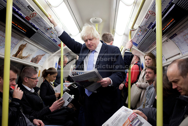 03/05/2012. LONDON, UK. London Mayor Boris Johnson is seen reading amongst commuters on the London Underground as he travels on the Northern Line after casting his vote in the 2012 mayoral and council elections in London today (03/05/12). Photo credit: Matt Cetti-Roberts