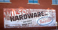 Old sign on the side of a building in Claremore Oklahoma on Route 66.