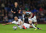 Nordin Amrabat of Watford tackles Steven Defour of Burnley during the Premier League match at Turf Moor Stadium, Burnley. Picture date: September 26th, 2016. Pic Simon Bellis/Sportimage