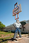 Man cut-out holding the Co-Op sign, downtown Jet, Okla.