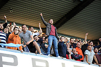 Fans of Swansea City celebrate at full time of the Sky Bet Championship match between Millwall and Swansea City at The Den in London, England. September 1, 2018