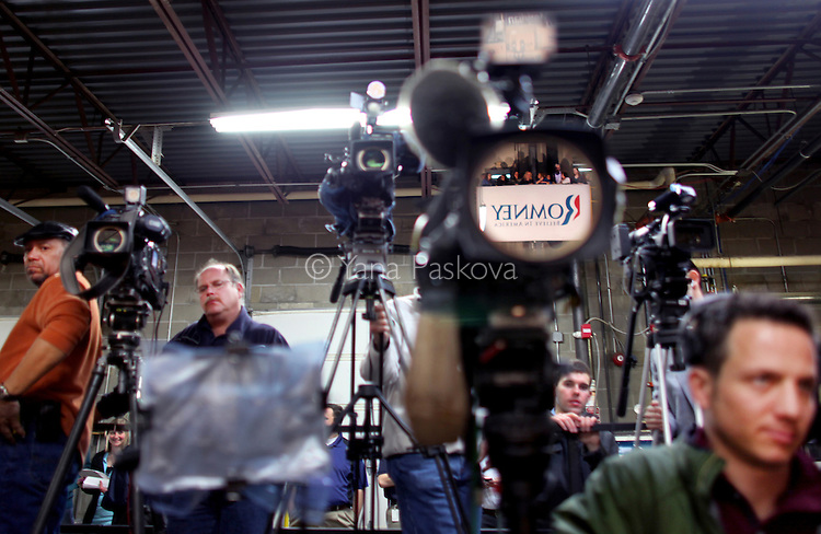 A sign is reflected in a video camera as media awaits Republican Presidential candidate Mitt Romney (R-MA) to speak at Meridian Bioscience in Cincinnati, Ohio on Monday, February 20, 2012. (Photo by Yana Paskova for The New York Times)<br /> <br /> Assignment ID: 30121494A