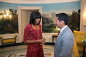 First Lady Michelle Obama greets David Hall, one of eight Citizen Co-Chairs for the Inauguration, in the Diplomatic Reception Room of the White House, Jan. 17, 2013..Mandatory Credit: Lawrence Jackson - White House via CNP