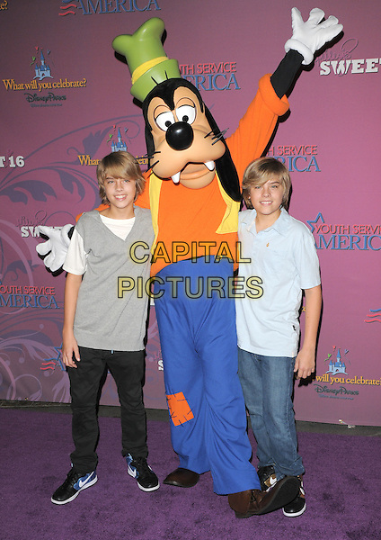 COLE & DYLAN SPROUSE & GOOFY.The Miley Cyrus Sweet 16 Birthday Celebration at Disneyland in Anaheim, California, USA..October 5th, 2008.full length jeans denim black white grey gray brothers siblings family dress-up costume blue orange green hat .CAP/DVS.©Debbie VanStory/Capital Pictures.