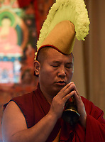 NWA Democrat-Gazette/CHARLIE KAIJO Monk Yeshi Topgyal of Minnesota, Minn chants during the Creation of the Healing Sand Mandala ceremony, Sunday, November 4, 2018 at the Basin Park Hotel in Eureka Springs.<br />